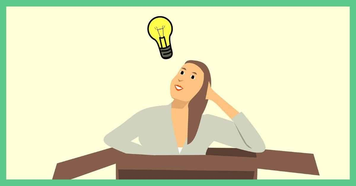 This is a cartoon image. There's a picture of a woman sat in a carboard box. There is a lightbulb above the woman's head.