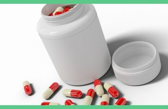 The image shows a white tub. The lid is off. You can see white and red capsules within the medicine tub and around it. The background is white and the image has a green border around it.