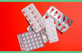 The image shows packets of tablets, set against a red background.