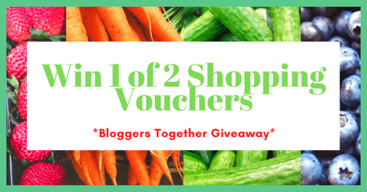 The picture shows some fresh fruit. The writing over the fruit says: 'win 1 of 2 shopping vouchers – bloggers together giveaway'. There is a green border around the image.