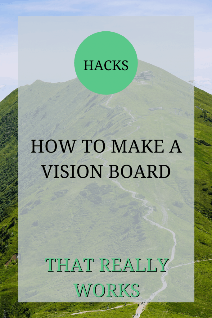 The image shows a mountain. The picture has been taken from the bottom, looking up. The text over the image reads: 'hacks: how to make a vision board that really works.'