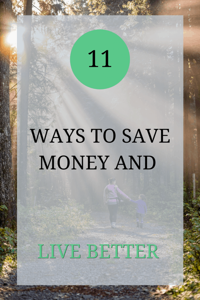 The image shows the back of a mother and daughter. They are walking through a forest and the light is shining through the trees. Over the image the text reads: '11 ways to save money and live better'.