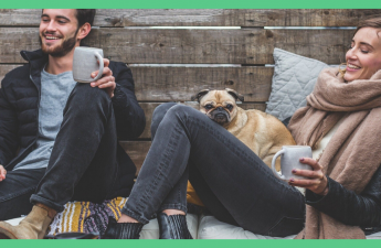 The image shows a man and woman in casual clothes, laughing. There's a dog on the woman's knee, The couple look very content. The image has a green border.