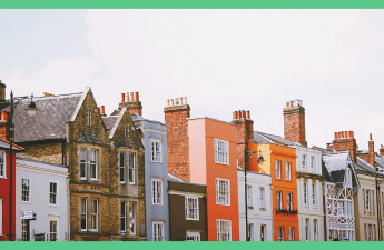 The image shows a row or terrace houses. The image has a green border.