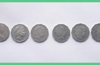 This image shows six 50 pence pieces (GBP). The image has a green border. The image is being used as a feature image on an article about free money.