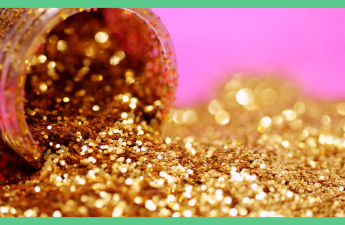 The image a pot of gold glitter open on its side. The hackground is pink. The image has a green border.
