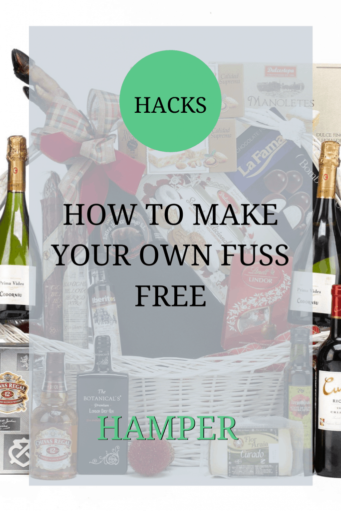 The image shows a hamper of food. The text over the image reads: 'hacks: how to make your own fuss free hamper'.