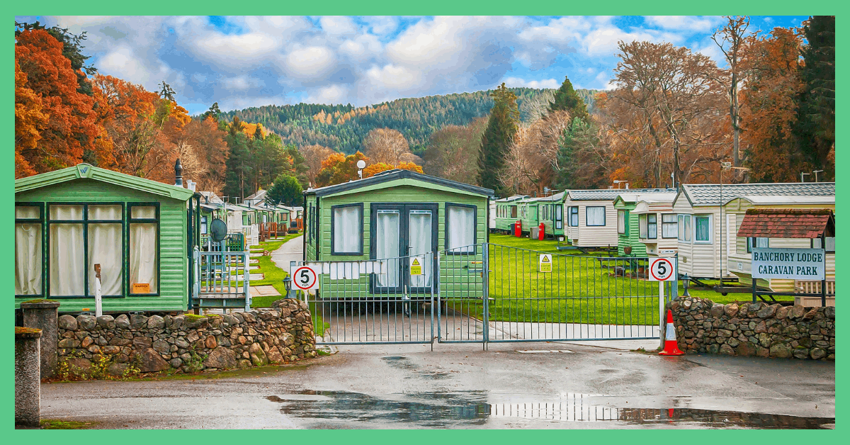 A row of caravans in a caravan park. Being used in an article explaining how to book a cheap holiday.