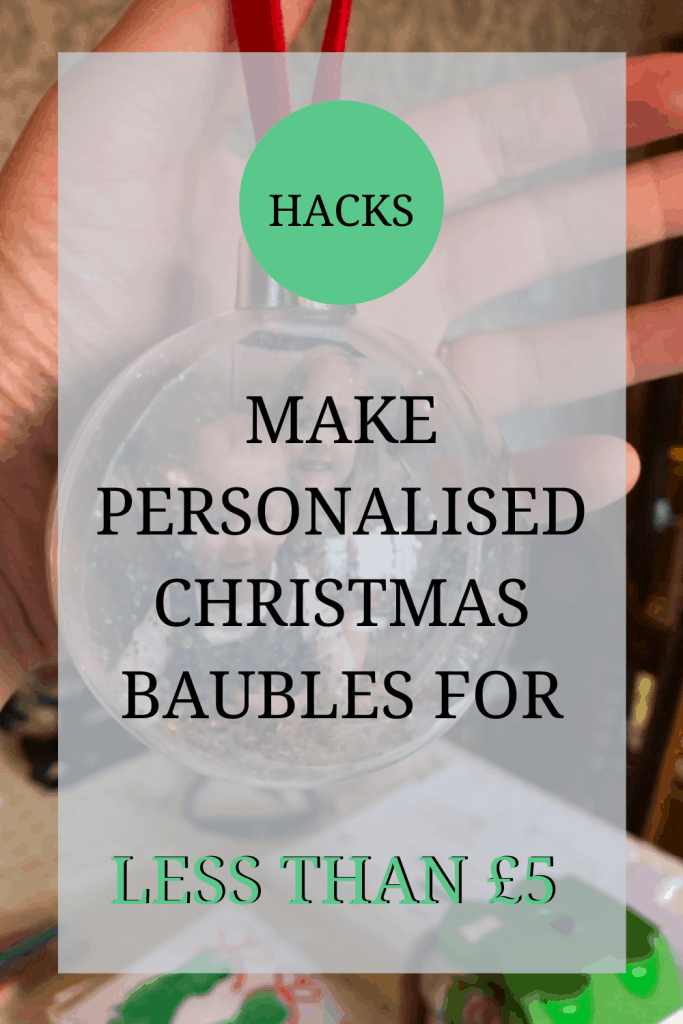 The image shows somebody holding a bauble with a picture of a little girl and a baby in it. Over the image, the text reads: 'hacks: make personalised Christmas baubles for less than £5'.