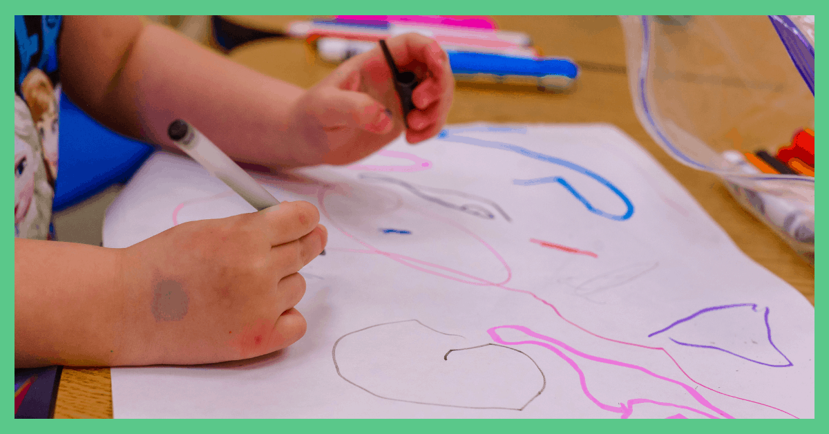 The image shows a child colouring in. The picture is being used in an article about choosing a childcare provider.