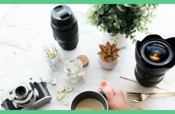 The image shows some camera lenses and a woman holding a cup of tea. The picture has a green border. The image illustrates an article about being happy at home.,