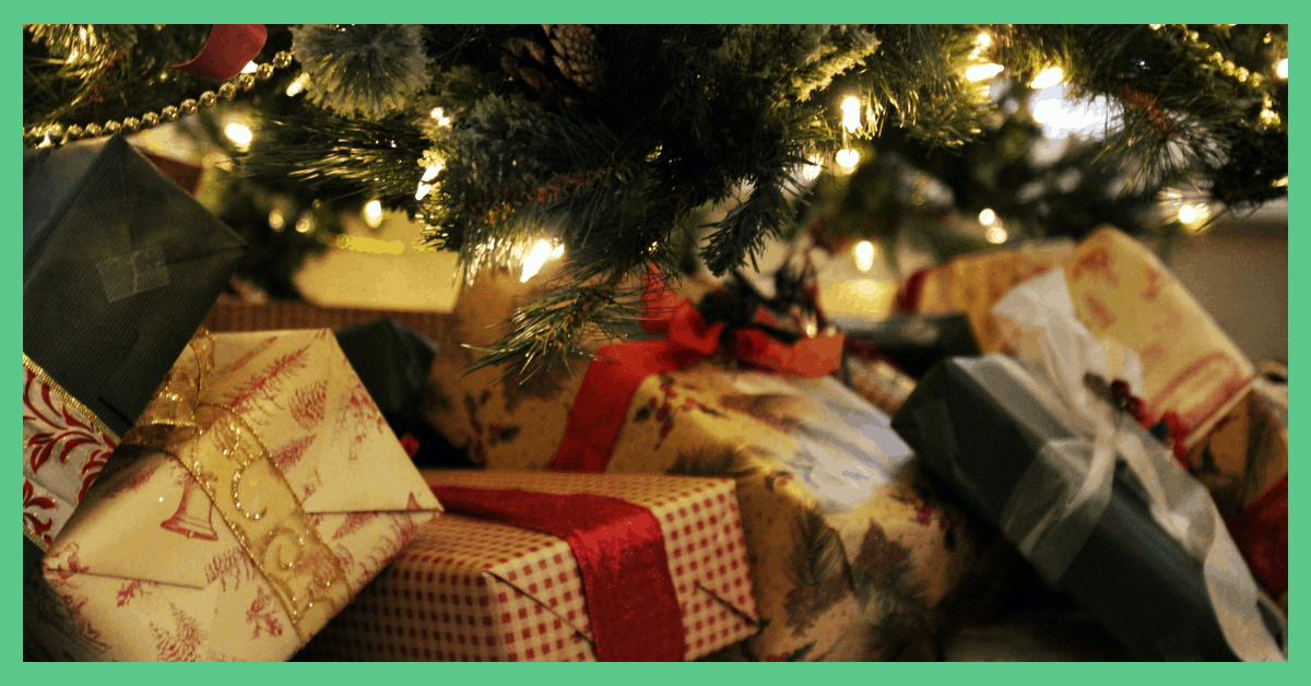 Wrapped gifts under a Christmas tree. Being used in an article about Christmas Day hacks.