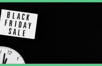 The image shows a clock and has a sign on it saying 'Blacks Friday Sale'.