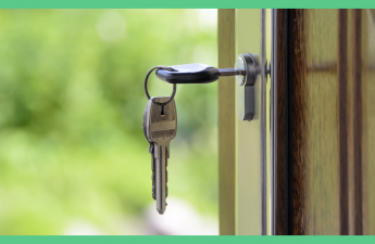 The image shows a key in a door. The picture has a green border.