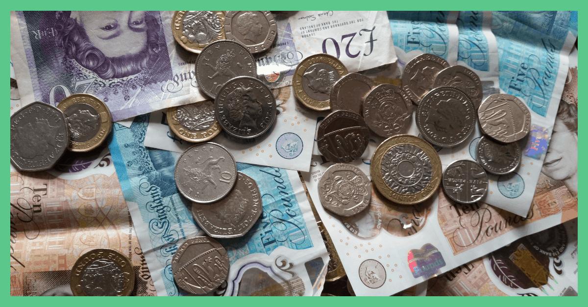 A pile of cash (GBP).