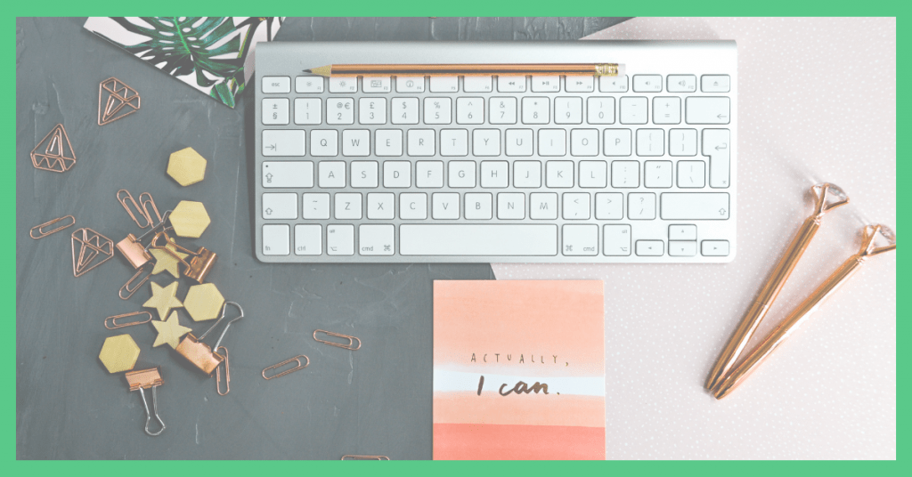 Image shows a computer and a 'I can sign' on a desk. The picture has a green border.