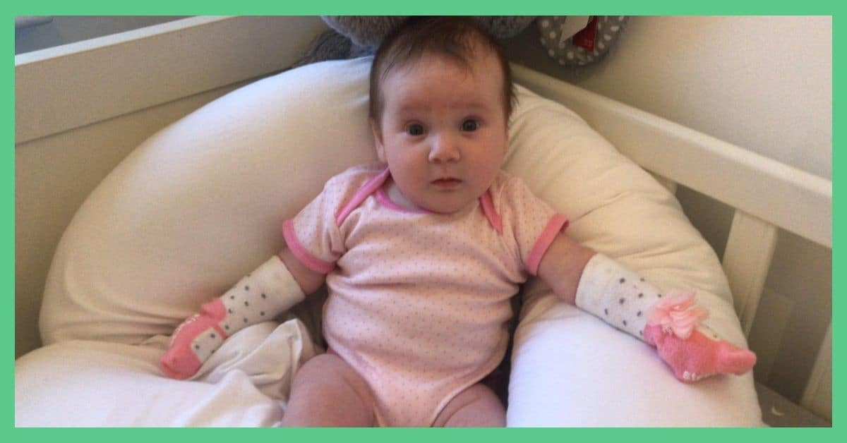 Scratch mittens - alternative solutions - baby girl Valentina is pictured